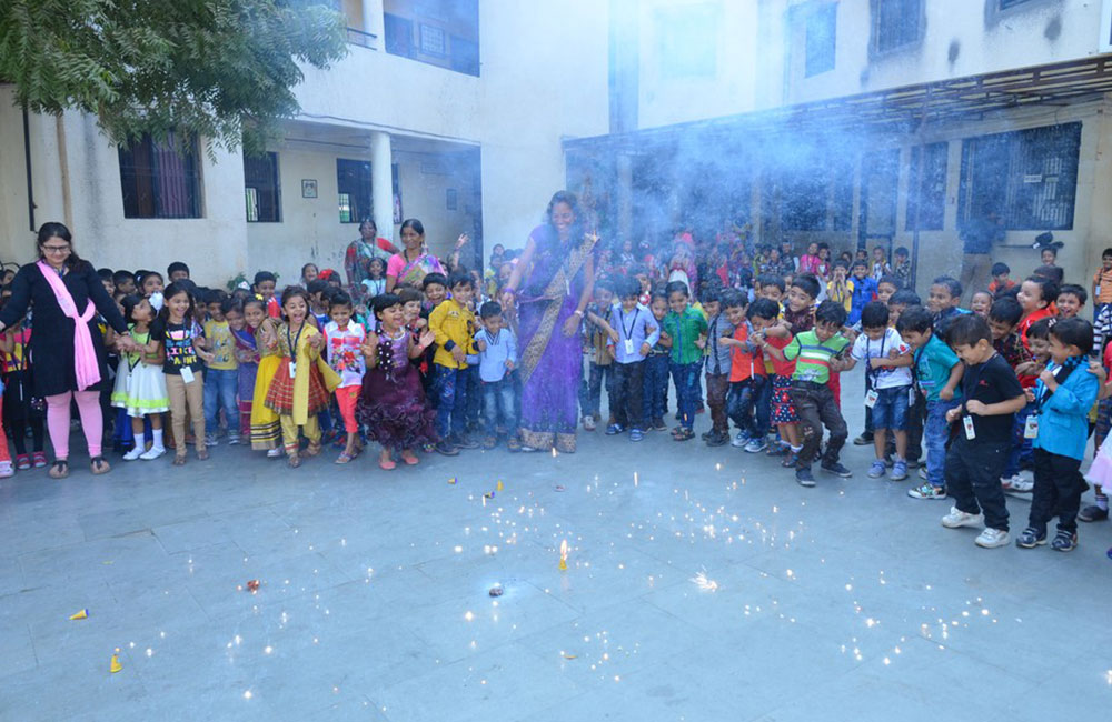 kids enjoying diwali crackers in bps school vadodara